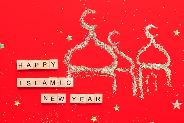 L'iscrizione felice anno nuovo islamico su un colore rosso