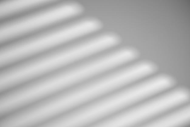 L'ombra dalla finestra su un muro bianco in tempo soleggiato con luce intensa. effetto di sovrapposizione dell'ombra per la foto.