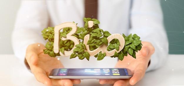 L'uomo d'affari che tiene il logo di legno bio- con le foglie intorno alla rappresentazione 3d