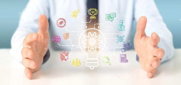 L'uomo d'affari che tiene un concetto di idea della lampada di lampadina con inizia l'icona ha collegato la rappresentazione 3d