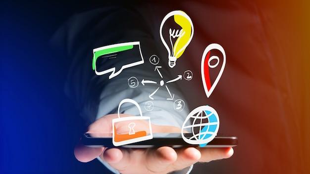 L'uomo d'affari che tiene un'icona disegnata a mano dell'affare, delle multimedia e della tecnologia - inizia sul concetto