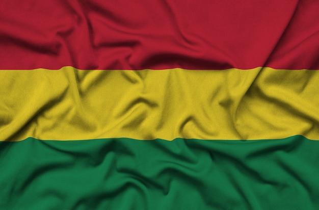 La bandiera della bolivia è raffigurata su un tessuto sportivo con molte pieghe.