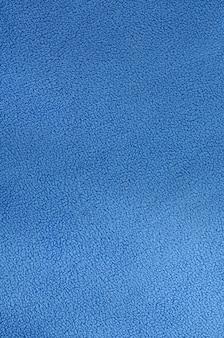 La coperta di tessuto in pile blu furry