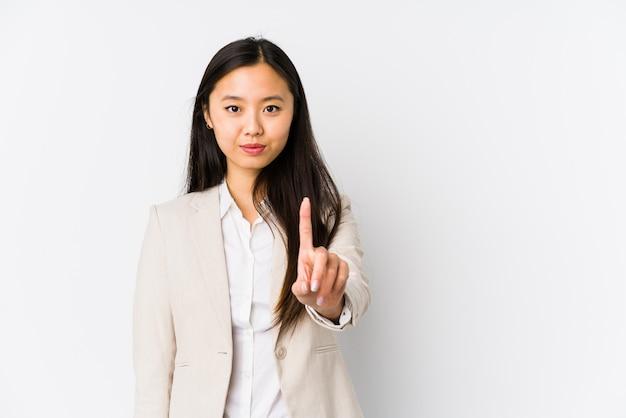 La donna cinese dei giovani affari ha isolato la mostra del numero uno con la barretta.