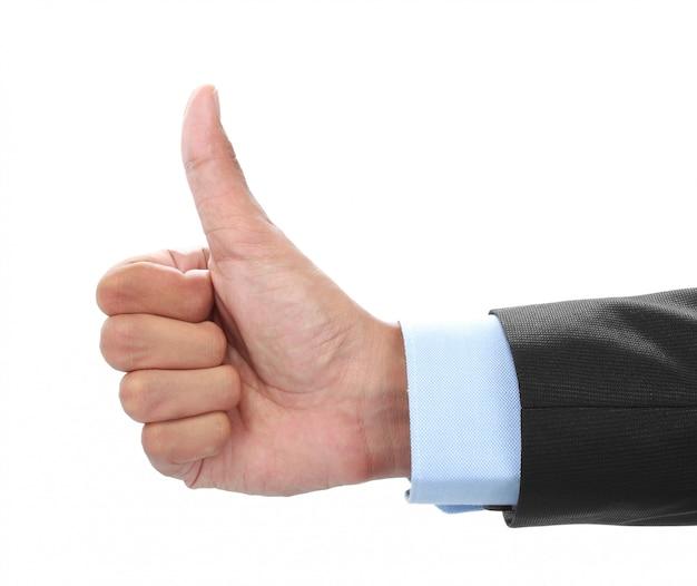 La mano dell'uomo d'affari che mostra i pollici aumenta il segno