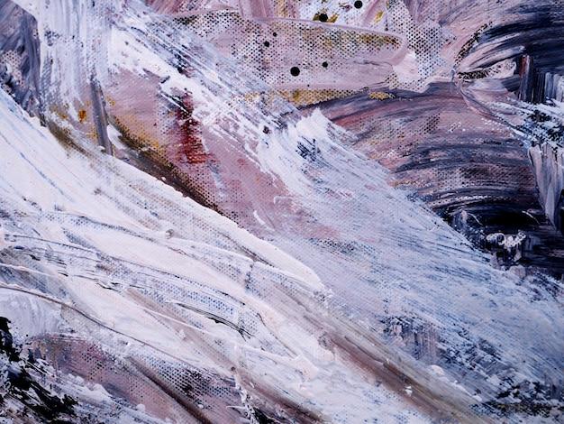 La mano disegna il fondo e la struttura astratti del colpo della spazzola della pittura ad olio variopinta.