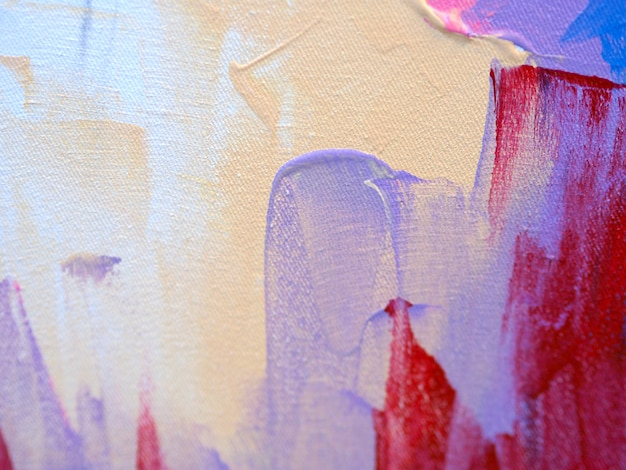 La mano disegna il fondo e la struttura astratti della pittura ad olio variopinta.