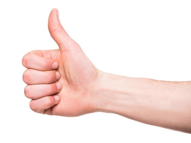 La mano maschio sta mostrando i pollici in su firma sopra.