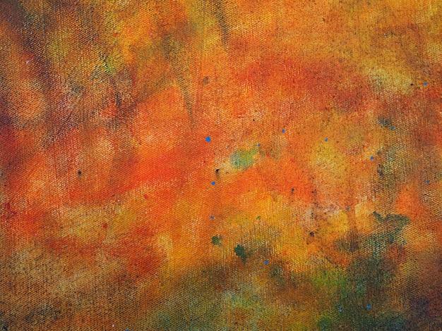 La mano variopinta della pittura a olio disegna il fondo astratto.