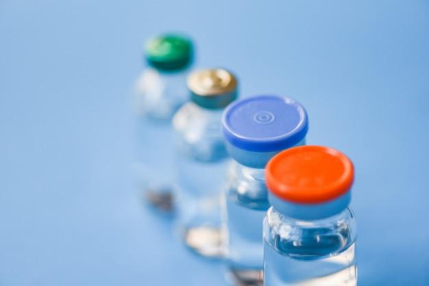 La medicina imbottiglia il vetro per l'ago della iniezione della siringa - strumento medico dell'attrezzatura della bottiglia della droga del farmaco per l'infermiere o medico