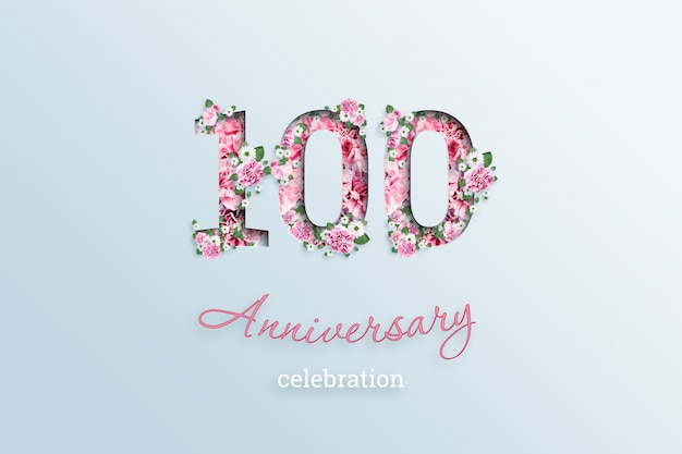 La scritta numero 100 e la celebrazione dell'anniversario textis fiori, su una luce