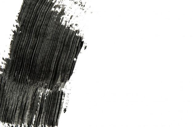 La spazzola nera della mascara segna il fondo con copyspace