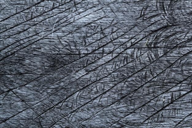 La struttura della taglia della motosega ha invecchiato il legno grigio invecchiato