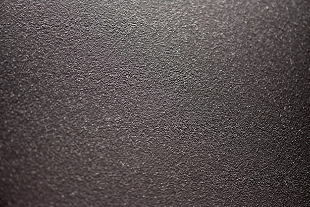 La struttura fine della vernice in polvere su una piastra di metallo