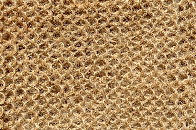 La trama del tessuto a maglia dai fili di fibre di lana naturali