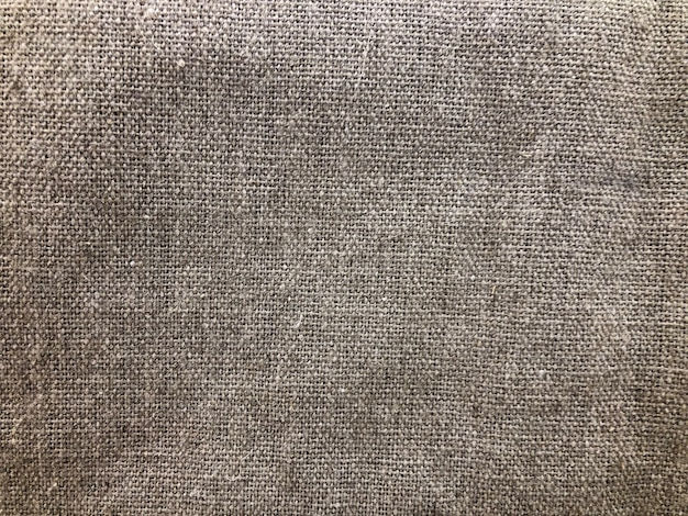 La trama del tessuto naturale è di juta, marrone. decorazione interna, germoglio di stile materiale
