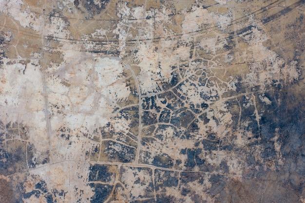 La trama del vecchio muro di cemento per lo sfondo