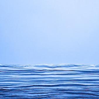 La trama dello sfondo raffigura il tessuto ondulato blu con pieghe parallele o diagonali su carta ruvida
