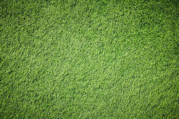 La trama di erba verde artificiale con filtro vintage può essere utilizzata come sfondo