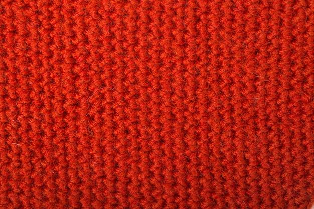 La trama di lana lavorata a maglia rossa può essere utilizzata come sfondo.