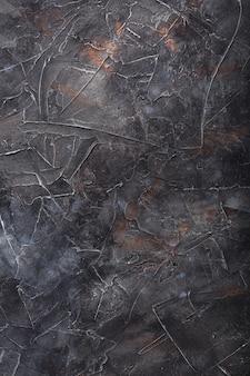 La trama di pietra del muro è di colore grigio scuro con macchie in stile loft. schermo intero come a