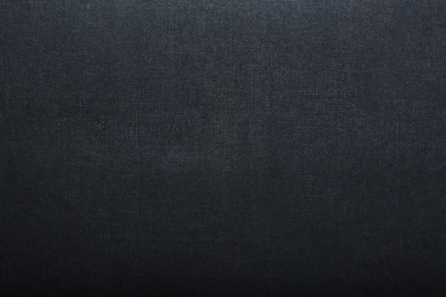 La trama di un tablet nero pagina vuota per pastelli. sfondo nero di trama della carta.