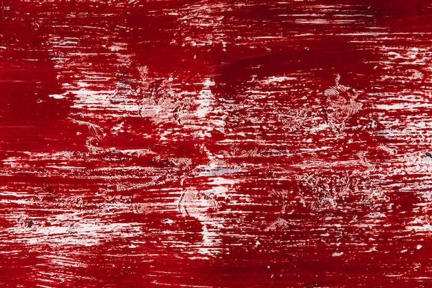 La vecchia parete con colore rosso sporco della pittura assomiglia al fondo di struttura della macchia dello sfregamento di lerciume del sangue