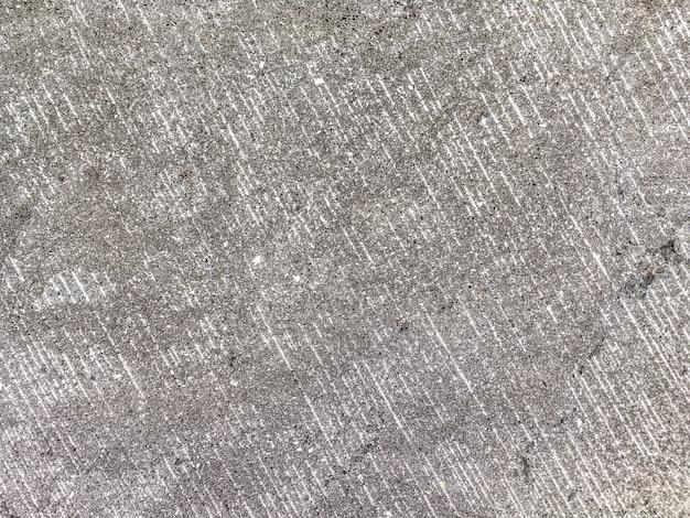 La vecchia superficie di pietra piatta, sfondo grigio antico frantumato
