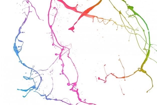 La vernice colorata spruzza isolato su priorità bassa bianca.