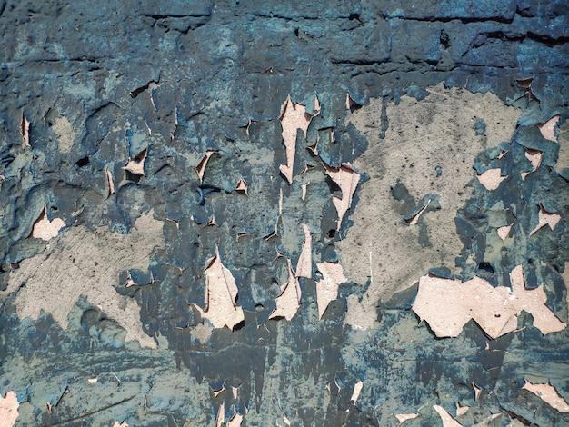 La vernice incrinata del muro di cemento, dipinge astrattamente dietro il calcestruzzo. trama, superficie, sfondo. vecchia vernice