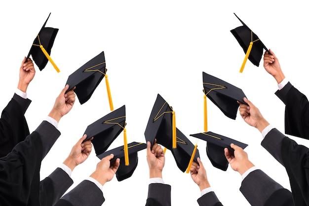 Laureati dell'università, di laureati in possesso di cappelli consegnati al cielo.