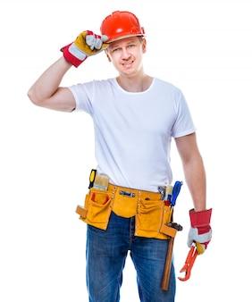 Lavoratore bello in un casco o