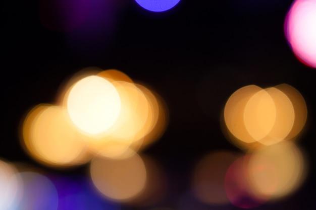 Le luci hanno offuscato il fondo del bokeh dalla festa di notte per la vostra progettazione