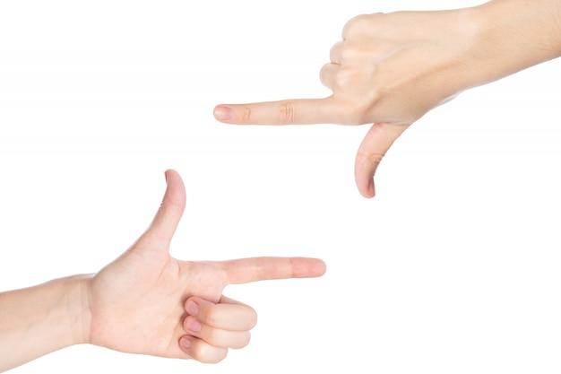 Le mani della donna mostrano il gesto della struttura isoated su un fondo bianco