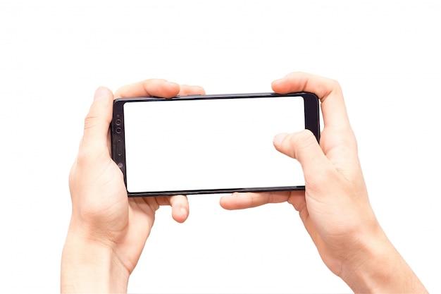 Le mani isolate con il telefono si chiudono su, mani che giocano il telefono