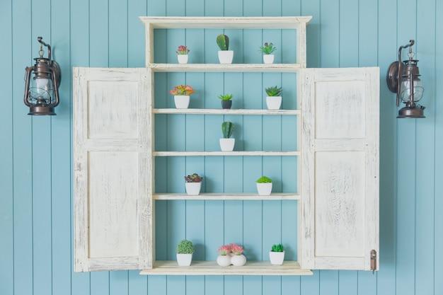 Legno blu con parete di legno di colore verde oceano decorazione domestica piccolo giardino con vaso