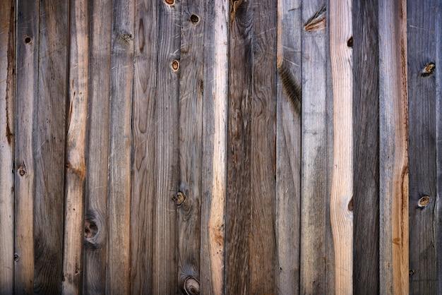 Lerciume di legno grigio di struttura della parete delle bande