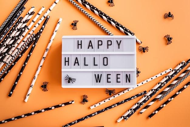 Lightbox felice del cinema di halloween con i ragni e le cannucce in bianco e nero