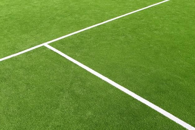 Linee bianche di struttura del campo di erba verde di paddle tennis