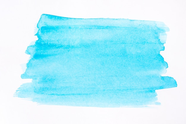 Linee blu di pennello dipinte su sfondo bianco