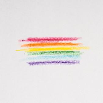 Linee di arcobaleno disegno con matite su sfondo grigio