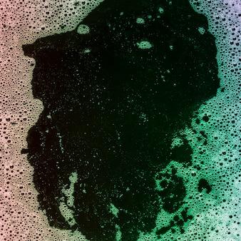 Liquido colorato sfumato con bolle