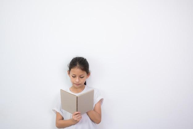 Llittle student girl reading book