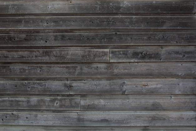 Lo sfondo di legno verniciato grigio stagionato