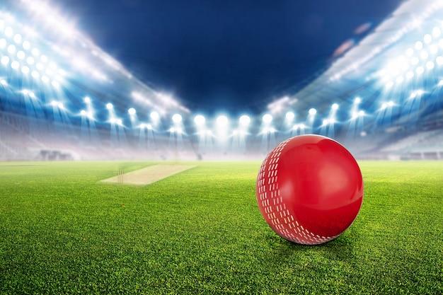 Lo stadio del cricket con la palla a luci e lampeggia 3d rendono