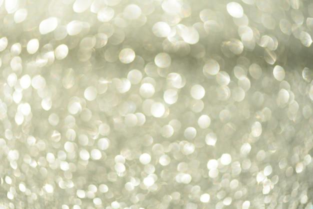 Luci astratte d'argento del bokeh. sfondo sfocato con spazio di copia.