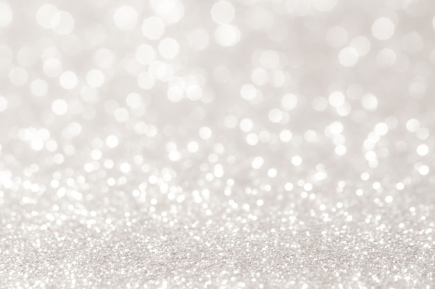 Luci bokeh argento e bianco sfocato. sfondo astratto