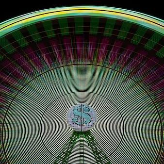 Luci del movimento della ruota della meraviglia con il simbolo di dollaro