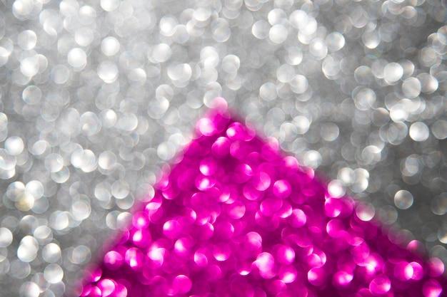 Luci di bokeh astratte d'argento e rosa