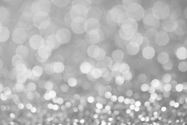 Luci di bokeh grigio e bianco defocalizzato. sfondo astratto
